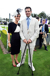 PAUL STEWART son of racehorse owner Andy Stewart, who is recovering after being paralysed in a snow boarding accident earlier this year and BECKY POYTIN at day 1 of the annual Glorious Goodwood racing festival held at Goodwood Racecourse, West Sussex on 28th July 2009.
