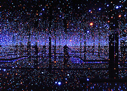 © Licensed to London News Pictures. 07/02/2012, London, UK. The photographer's reflection (centre) is seen in 'Infinity Mirrored Room - Filled With The Brilliance of Life 2011. This is Kusama's largest mirrored room to date. Press preview of Yayoi Kusama at the Tate Gallery Bankside today 7th February 2012. The exhibition spans six decades of the artists work. Kusama is one of Japan's best known living artists.  Photo credit : Stephen Simpson/LNP