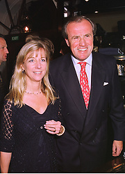 MR & MRS JUSTIN CADBURY at a party in London on 14th October 1998.MKU 28