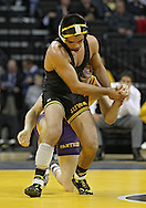 December 8, 2011: Iowa Hawkeyes Tony Ramos gets away from Northern Iowa Panthers Ryan Jauch in the 133 pound bout of the NCAA wrestling dual between the Northern Iowa Panthers and the Iowa Hawkeyes at Carver-Hawkeye Arena in Iowa CIty, Iowa on Thursday, December 8, 2011. Ramos defeated Jauch 15-5 and Iowa defeated Northern Iowa 38-4.