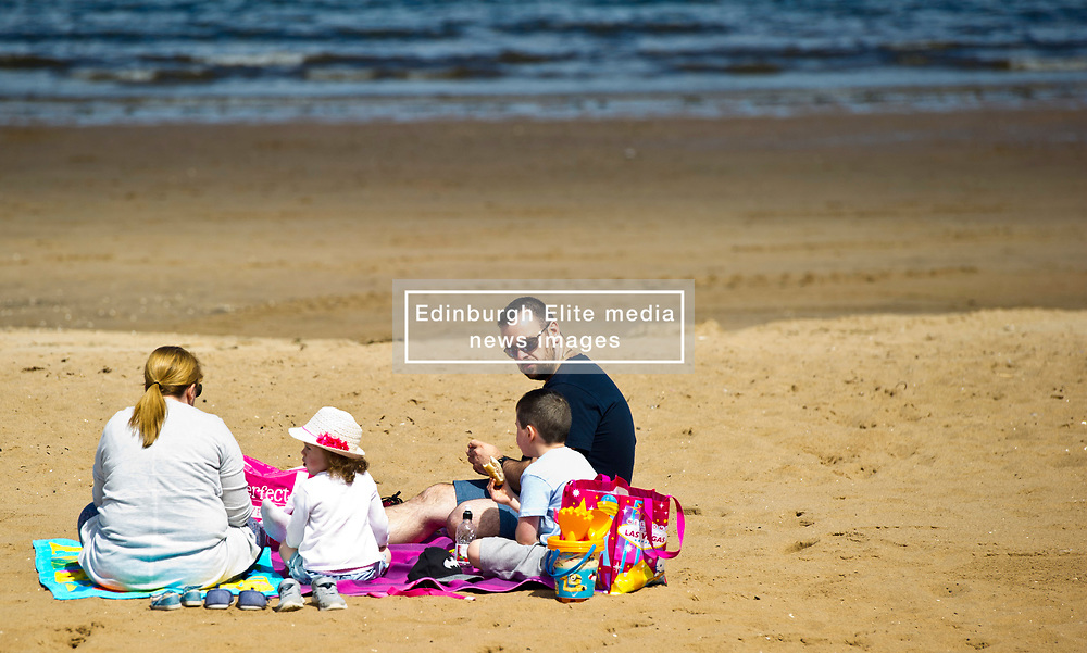 Pictured: <br /> Portobello Beach was the main attraction in Edinburgh today as the sun made an appearance after a number of dull wet days.<br /> <br /> <br /> Ger Harley   EEm 12 July 2017
