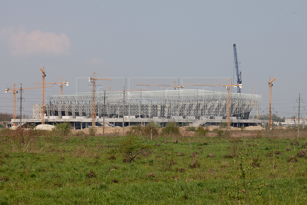 © licensed to London News Pictures. Lviv, Ukraine 29/04/2011. The Lviv New Stadium under construction in Lviv, Ukraine. Construction is due to be complete in July 2011. It will seat up to 33,500 fans and will host several stages of the Euro 2012 football tournament, hosting of which has been jointly awarded to Ukraine and Polandc. Photo credit should read Joel Goodman/LNP