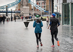 Joggers on the South Bank in London.
