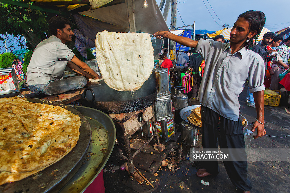 Kashmiri Parantha, being prepared on the streets of Kashmir. ..Devotees converged for peace prayers at the famous Muslim shrine of Hazratbal to mark Meraj-ul-Alam festival in Srinagar, Prophet Mohammed's Moi-e-Muqaddas (Holy Relic) is displayed for public viewing on ten occasions in a year, which includes Meraj-ul Alam.