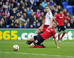 Bristol City's Steven Davies struggles to get his shot away under pressure from Cardiff City's Ben Nugent and it's easily picked up by Cardiff City's David Marshall - Photo mandatory by-line: Joe Meredith/JMP - Tel: Mobile: 07966 386802 16/02/2013 - SPORT - FOOTBALL - Cardiff City Stadium - Cardiff -  Cardiff City V Bristol City - Npower Championship