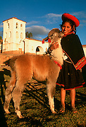 PERU, MARKETS AND CRAFTS Chincheros, Quechua girl and llama