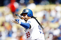 19 July 2009: Left fielder #99 Manny Ramirez tosses his bat after being walked during the MLB Los Angeles Dodgers 4-3 win over the Houston Astros on a warm summer day in LA at Chavez Ravine during a National League Professional Baseball game.