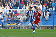Brighton defender, full back, Liam Rosenior advances upfield from Cardiff City midfielder Joe Ralls during the Sky Bet Championship match between Brighton and Hove Albion and Cardiff City at the American Express Community Stadium, Brighton and Hove, England on 3 October 2015. Photo by Geoff Penn.