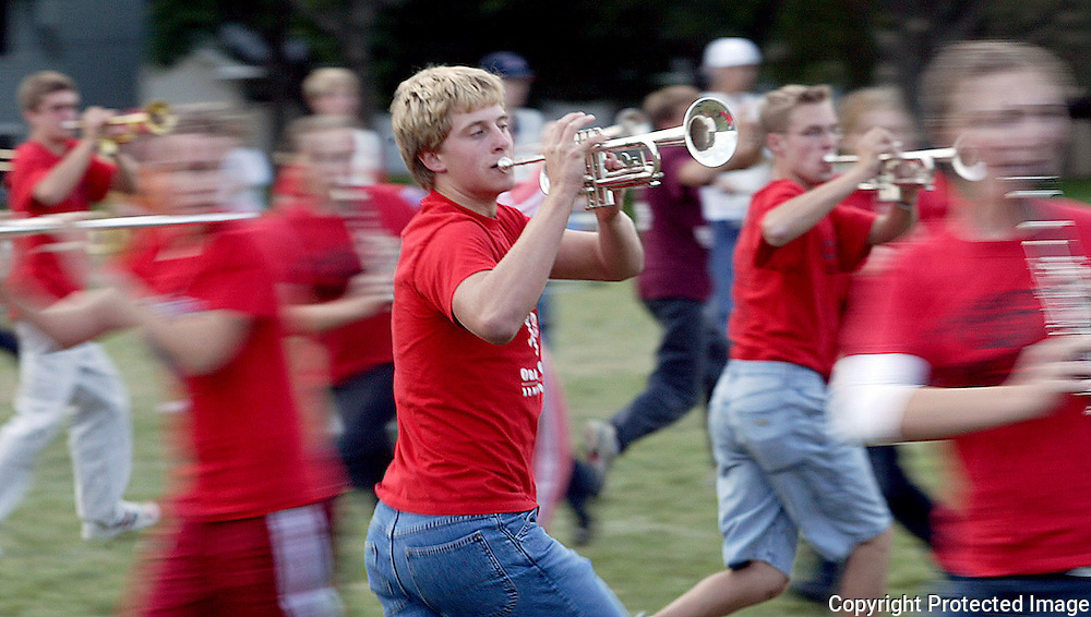 "Junior trumpet player Curtis Bomgaars, center, moves swiftly with the rest of the MOC Floyd Valley band as they rehearse ""Whirlwind"", a field competition piece of music which is built on momentum.  The purpose of the show is to ""shake up audiences and bands everywhere."" wrote Peter Connell, son of band director Steve Connell, who conceived of and wrote the music.  ""I want ooohhhhss...ahhhhhhsssss...wooooooeeeeeessss... heads turning, jaws dropping."""