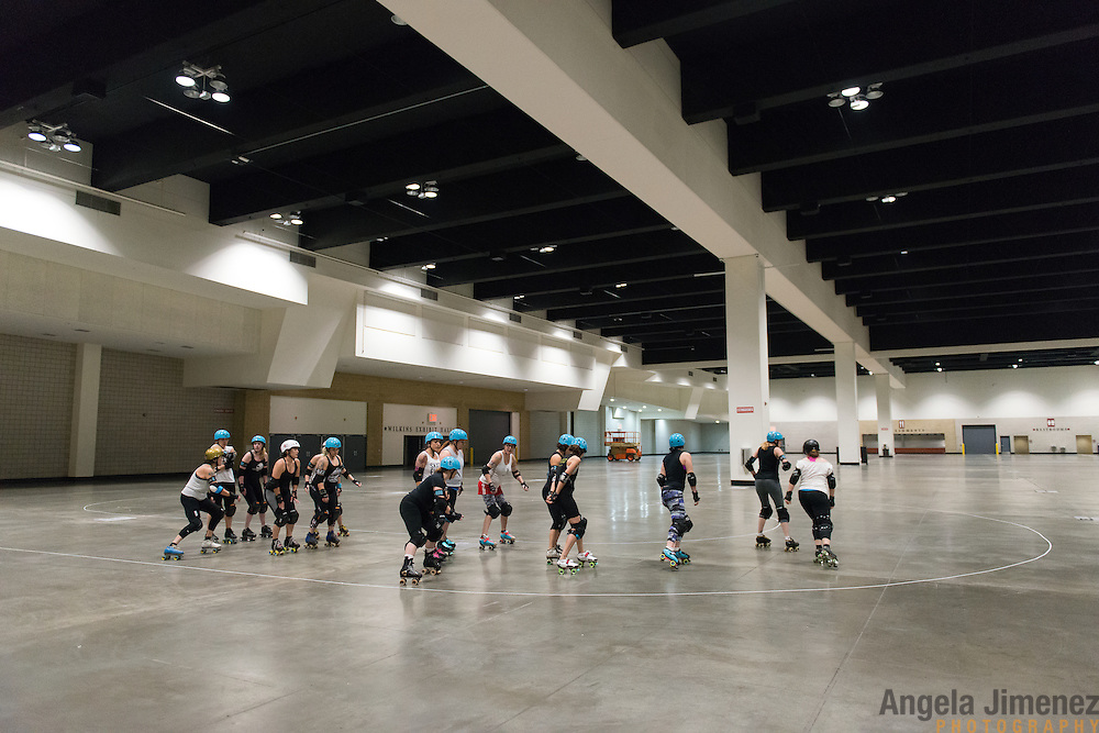 The Minnesota RollerGirls All-Star team warms up at the start of practice in Exhibit Hall B at the Saint Paul RiverCentre in Saint Paul, Minnesota on November 3, 2015. <br /> <br /> The team is preparing to compete in, and host, the 2015 International WFTDA Championships at the Legendary Roy Wilkins Auditorium here in Saint Paul, Minnesota from November 6-8, 2015. <br />  <br /> Photo by Angela Jimenez for Minnesota Public Radio www.angelajimenezphotography.com