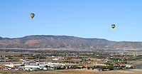Don's Early Light hot air balloon has a view of Lancaster and Palmdale along with two balloons, all of which took off from Lancaster early Saturday morning.  KELLY LACEFIELD Aug 19, 2006