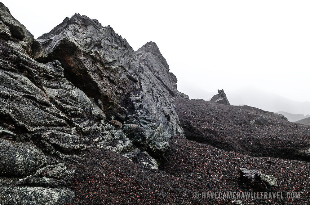 Some of the rugged terrain formed by the solidified lava flows at the summit of Pacaya Volcano. Pacaya is an active volcano that forms part of the Central America Volcanic Arc. It forms a popular tourist destination easily accessible from Antigua and Guatemala City. Situated within the Pacaya National Park, it rises to 2,552 metres (8,373 ft). Its last major eruption, which caused considerable damange to nearby villages and reshaped the summit, was in May 2010. That eruption and scattered volcanic ash over much of the nearby area, prompting school closings and emergency evacuations and cleared much of the vegetation near the top of the mountain.