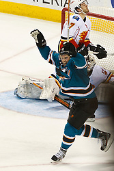 Jan 17, 2012; San Jose, CA, USA; San Jose Sharks left wing Torrey Mitchell (17) celebrates after scoring a goal against the Calgary Flames during the third period at HP Pavilion. San Jose defeated Calgary 2-1 in shootouts. Mandatory Credit: Jason O. Watson-US PRESSWIRE