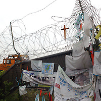 PANMUNJOM, MAY-16: barbed wire and a cross on  seperate the freedom bridge from no man's land