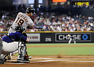 Sep. 15, 2012; Phoenix, AZ, USA; San Francisco Giants infielder Marco Scutaro (19) hits an RBI single during the game against the Arizona Diamondbacks in the first inning at Chase Field. The Giants defeated the Diamondbacks 3-2. Mandatory Credit: Jennifer Stewart-US PRESSWIRE