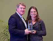 ACC Commissioner John D. Swofford presents former Virginia Tech star Lisa Witherspoon Hansen with her Women's ACC Legends Award at the 2011 ACC Legends Banquette held at the Terrace Greensboro Coliseum Complex in Greensboro, North Carolina.  (Photo by Mark W. Sutton)