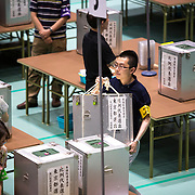 TOKYO, JAPAN - JULY 10 : Election staff members carries ballot boxes for official counting in Parliament's upper house elections at a ballot counting center in Shinjuku Cosmic Sports Center in Tokyo on Sunday, July 10, 2016 in Tokyo, Japan. (Photo by Richard Atrero de Guzman/NUR Photo)