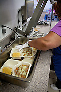 Hot meals are packaged for delivery Torrance County senior citizens. New Mexico has received more than $601,000 for senior meals programs around the state.