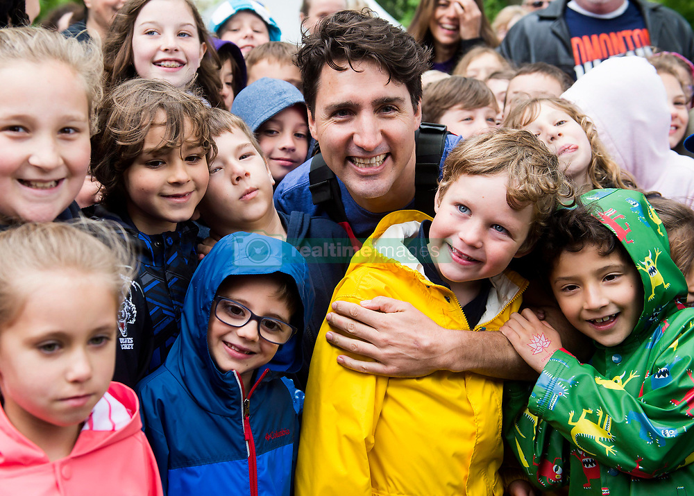 Prime Minister Justin Trudeau poses for a photograph with kids after kayaking on the Niagara River in Niagara-on-the Lake, Ont., on Monday, June 5, 2017. Trudeau was promoting World Environment Day. Photo by Nathan Denette/CP/ABACAPRESS.COM