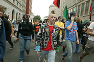Black Bloc Anarchists take over a street during the anti-war march on Washington.