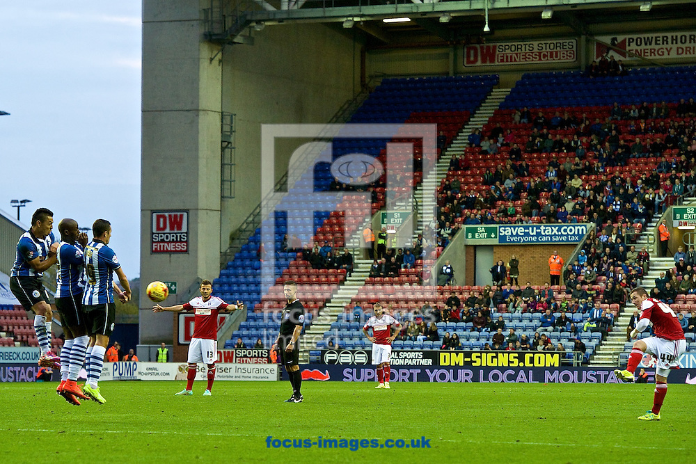 Ross McCormack of Fulham (right) hits a free kick during the Sky Bet Championship match at the DW Stadium, Wigan<br /> Picture by Ian Wadkins/Focus Images Ltd +44 7877 568959<br /> 01/11/2014