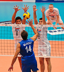 18.09.2011, Stadthalle, Wien, AUT, CEV, Europaeische Volleyball Meisterschaft 2011, Finale, Italien vs Serbien, im Bild Ivan Miljkovic, (SRB, #14, Opposite) gegen Luigi Mastrangelo, (ITA, #1, Middle-Blocker) und Cristian Savani, (ITA, #11, Wing-Spiker) // during the european Volleyball Championship Final Italy vs Serbia, at Stadthalle, Vienna, 2011-09-18, EXPA Pictures © 2011, PhotoCredit: EXPA/ M. Gruber