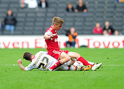 Bristol City's Joe Bryan is fouled by Milton Keynes Dons' Samir Carruthers  - Photo mandatory by-line: Dougie Allward/JMP - Tel: Mobile: 07966 386802 24/08/2013 - SPORT - FOOTBALL - Stadium MK - Milton Keynes -  Milton Keynes Dons V Bristol City - Sky Bet League One