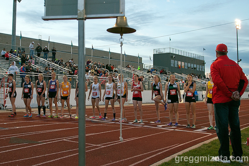 Before the start of the girl's 1600 meter run (L to R: Harlie Sorrell, Anna Hartwick, Holly Ellingson, Brittany Wilding, Emily Hammons, Sophie Stands, Sydney Taylor, Maggie Haener, Anna Kreslins, Allison Armstrong, Brynn Pritchard, Sofia Loucao, Jenna Waldo, and Hannah Webster) during the YMCA Track & Field Invitational at Mountain View High School, Meridian, Idaho. April 24, 2015.