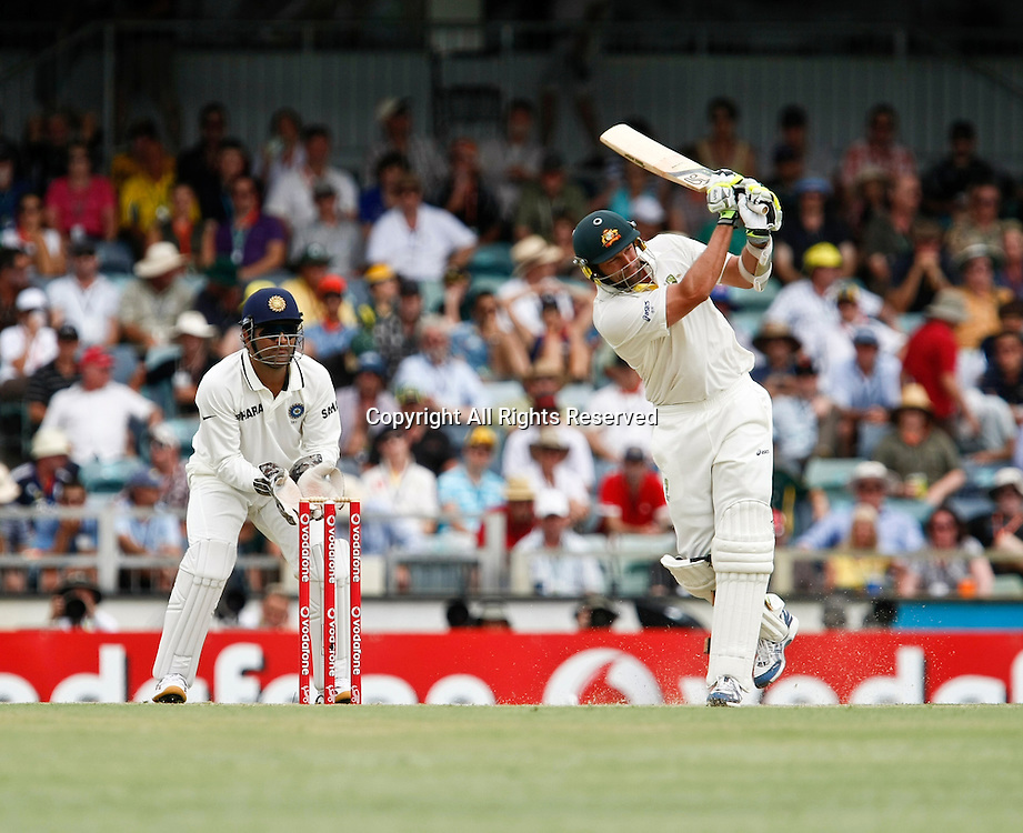 14.01.2012. Perth, Australia.  Ben Hilfenhaus hits out during the second day of the third Test between Australia and India at the WACA ground in Perth Western Australia.