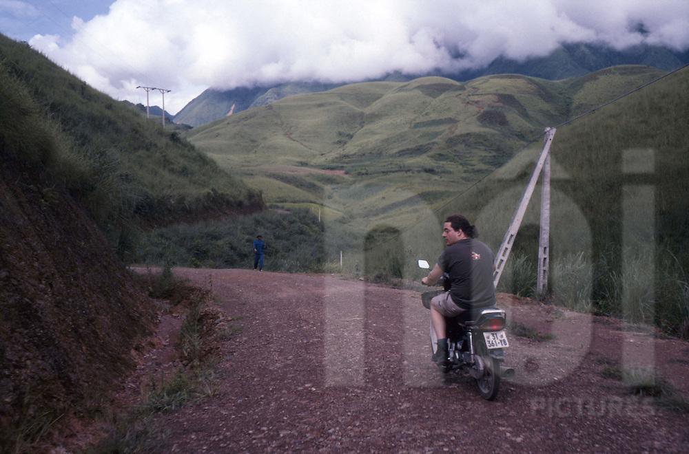 a tourist rides his motorbike near Binh Lu, Lao Chai Valley, Vietnam.