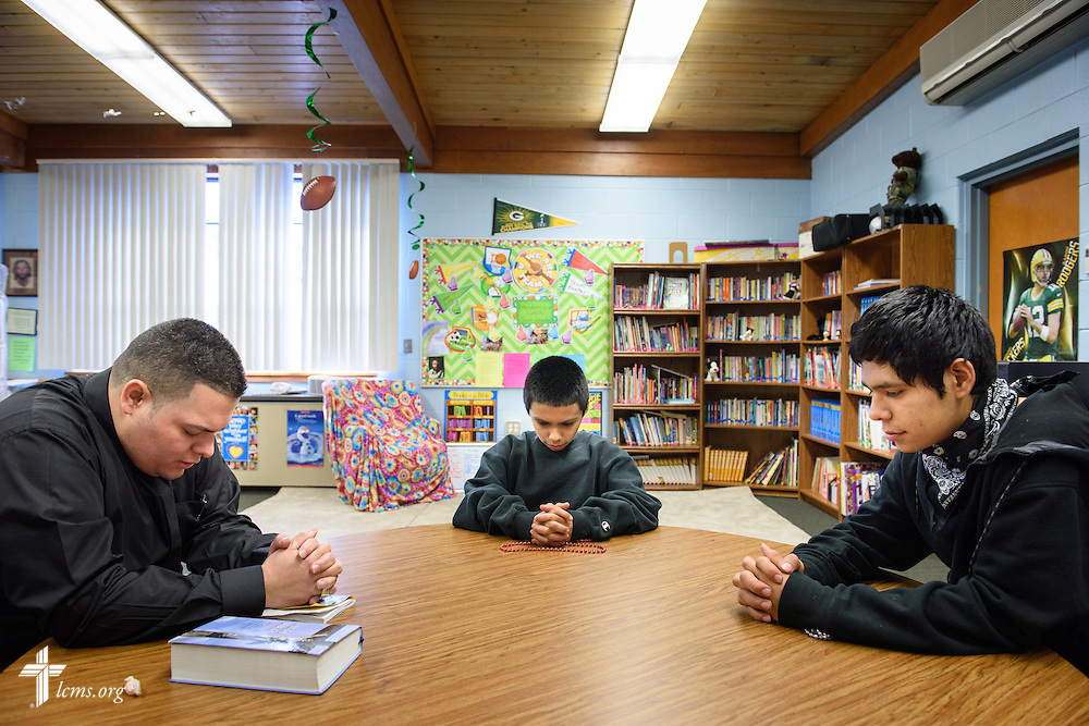 Vicar David Blas, missionary-at-large at LCMS Sheboygan County Hispanic Outreach and St. John's Lutheran Church of Plymouth, Wis., mentors Jose Vazquez (center) and Gustavo Lozano on Friday, Jan. 29, 2016, at Immanuel Evangelical Lutheran School in Sheboygan, Wis. LCMS Communications/Erik M. Lunsford