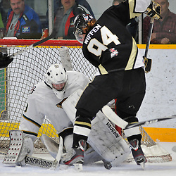 WHITBY, ON - Nov 2: Ontario Junior Hockey League game between Cobourg Cougars and Trenton Golden Hawks. Brady Wiffen #94 of the Trenton Golden Hawks and Nathan Perry #29 of the Cobourg Cougars battle for the puck during first period game action..(Photo by Shawn Muir / OJHL Images)