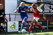 AFC Wimbledon midfielder Mitch Pinnock (11) takes on Fleetwood Town defender Tommy Spurr (6) during the EFL Sky Bet League 1 match between Fleetwood Town and AFC Wimbledon at the Highbury Stadium, Fleetwood, England on 4 August 2018. Picture by Craig Galloway.