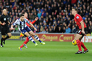 West Brom's Shane Long has a shot at goal blocked by Cardiff's Ben Turner ®. Barclays Premier league, Cardiff city v West Bromwich Albion at the Cardiff city Stadium in Cardiff, South Wales on Saturday 14th Dec 2013. pic by Andrew Orchard, Andrew Orchard sports photography.