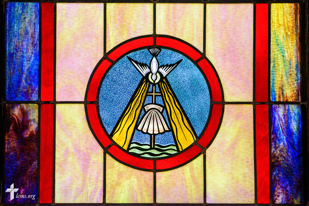 Stained glass depicting baptism and the Holy Spirit at Zion Evangelical Lutheran Church, Lu Verne, Iowa, on Sunday, July 9, 2017. LCMS Communications/Erik M. Lunsford