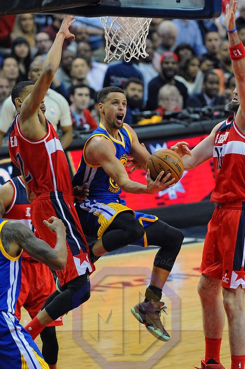 03 February 2016:  Golden State Warriors guard Stephen Curry (30) scores against Washington Wizards forward Otto Porter Jr. (22) at the Verizon Center in Washington, D.C. where the Golden State Warriors defeated the Washington Wizards, 134-121.  (Photograph by Icon Sportswire)