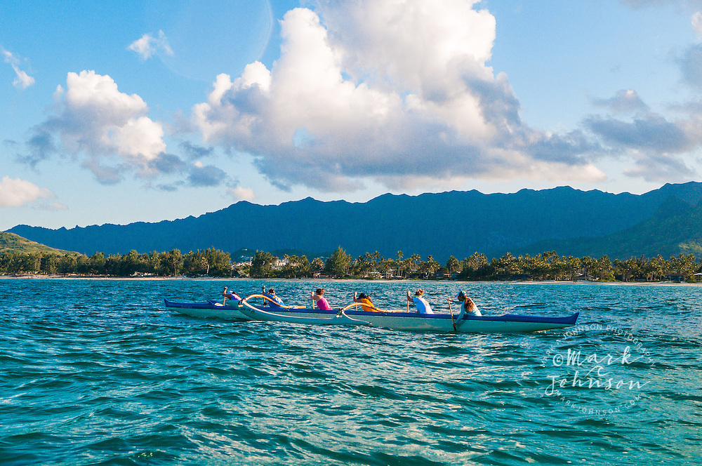 Woman's outrigger canoe team paddling in Kailua Bay, Oahu, Hawaii