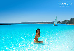 These incredible photos show the San Alfonso del Mar resort in Chile — home to the second largest swimming pool in the world. The outdoor pool is located halfway up the country's Pacific Coast in the city of Algarrobo and is filled with a staggering 66 million gallons of crystal clear seawater. Spanning an area of 20 acres — and equivalent in size to 6,000 average size home swimming pools — the San Alfonso pool, designed by water innovation company Crystal Lagoons, was until recently the Guinness World Record for the world's largest swimming pool. But in December 2015 a sister project by Crystal Lagoons in Sharm el Sheikh, Egypt, took over the title with the completion of a 30 acre pool, the first phase of plans for a total of 12 lagoons that will span 250 acres and the centerpiece of the USD $5.5 billion, 1,8500-acre Citystars project with residential apartments, hotels and shopping. Still, Sharm el Sheikh's older sister pool in Chile, at 3,323ft long with a maximum depth of 11.5ft, is still quite the sight to behold and will turn 11-years-old next month, after opening back in December 2006. The San Alfonso pool, situated right next to the Pacific Ocean, uses a computer-controlled filtration system to suck water from the sea at one end and pump it back out at the other. The sun warms the pool to 26 degrees Celsius (79 degrees Fahrenheit) — nine degrees Celsius (48 degrees Fahrenheit) warmer than the ocean. And being the size it is, swimming it not the only thing on the agenda — the gigantic size makes it possible to sail boats and carry out all kinds of fun water sports activities. 14 Nov 2017 Pictured: The San Alfonso del Mar resort in Algarrobo, Chile — home to the second largest swimming pool in the world. Photo credit: Crystal Lagoons/ MEGA TheMegaAgency.com +1 888 505 6342