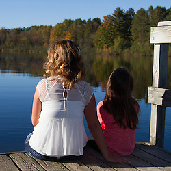 Mother and daughter enjoying a beautiful fall sunset.