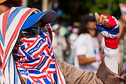 16 MAY 2014 - BANGKOK, THAILAND: A woman wearing patriotic clothing cheers for anti-government leader Suthep Thaugsuban in front of the parliament complex in Bangkok. Thousands of protestors from the People's Democratic Reform Committee (PDRC) surrounded the Thai Parliament complex Saturday to pressure the Thai Senate to select an interim Prime Minister to replace ousted former PM Yingluck Shinawatra. The Senate decided not to appoint an interim PM of their own and announced a meeting with the current interim Prime Minister. The protestors left the parliament complex and threatened to return in larger numbers if the Senate doesn't act. The Senate appointment of an acting PM could plunge Thailand into chaos since there is already an interim Prime Minister from the ruling Pheu Thai party.     PHOTO BY JACK KURTZ