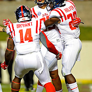 Mississippi linebacker Serderius Bryant (14) and defensive back Mike Hilton (28) celebrate with defensive back Cody Prewitt (25) after Prewitt's interception returned for a touchdown during the first half of an NCAA college football game in College Station, Texas, Saturday, Oct. 11, 2014. (Photo/Thomas Graning)