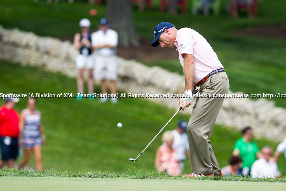 June 7, 2015:  Jim Furyk chips onto the eighth green during the final round of the Memorial Tournament presented by Nationwide Insurance held at Muirfield Village Golf Club in Dublin, Ohio.