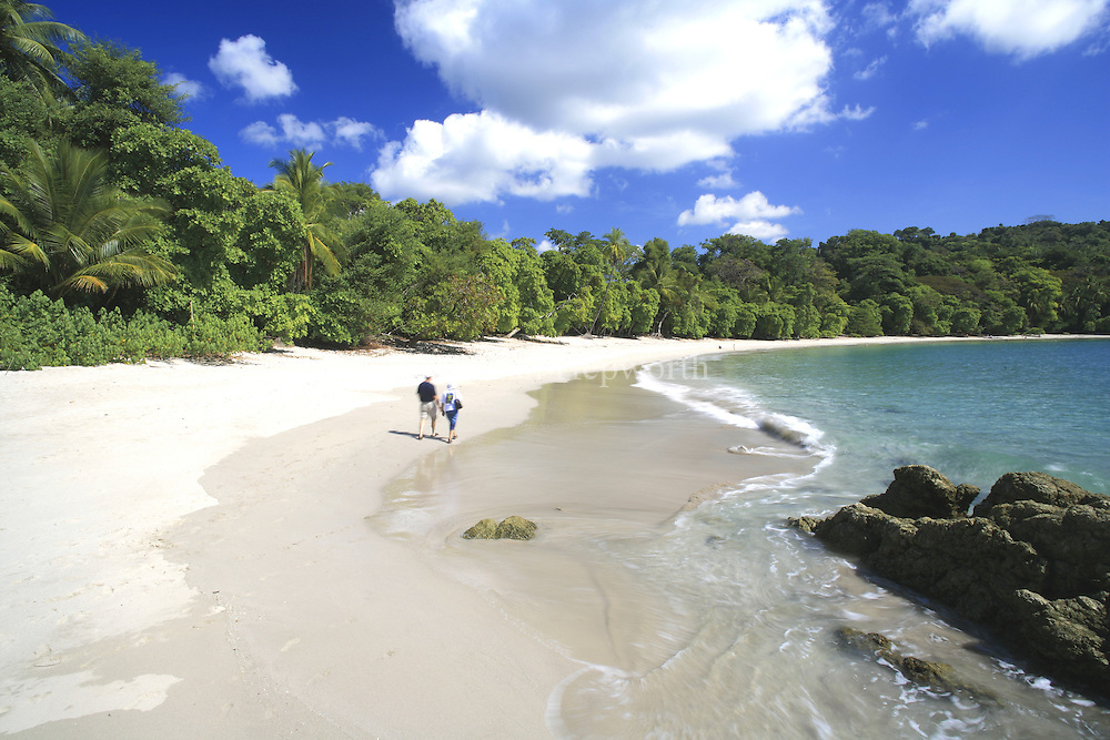 Tourists on Manuel Antonio Beach, Manuel Antonio National Park, Costa Rica.<br /> <br /> For pricing click on ADD TO CART (above). We accept payments via PayPal.