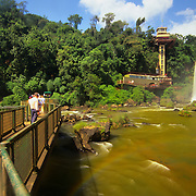 South America, Brazil, Igwacu Falls. Tourists stroll the boardwalk to see every dramatic angle of Igwacu Falls.