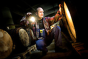 Peter Hurup inspects barrels at the Aalborg factory.<br />