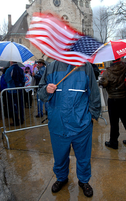 February 27, 2009 - Atlanta, Georgia :  Hundreds of people stood in the pouring rain outside the Georgia state capitol to protest the Obama administration's stimulus package. <br /> <br /> The &quot;Atlanta Tea Party&quot; was one of many Tea Party events that took place across the nation February 27, 2009. The idea originated from CNBC analyst Rick Santelli's on-air rants last week for a new &quot;tea party&quot; to protest the stimulus plan from the floor of the Chicago Mercantile Exchange.<br /> <br /> At the Atlanta event people clumped together under an array of umbrellas, many getting soaked to the bone during the rainstorm. The 40-minute demonstration included speeches by some members of the Georgia Legislature. <br /> <br /> The crowd whooped and roared as people from the microphone railed about the &quot;socialists running the country,&quot; called for extensive tax cuts, read the Declaration of Independence and defended the sanctity of the Constitution. The event ended with demonstrators dumping tea bags into a bucket.