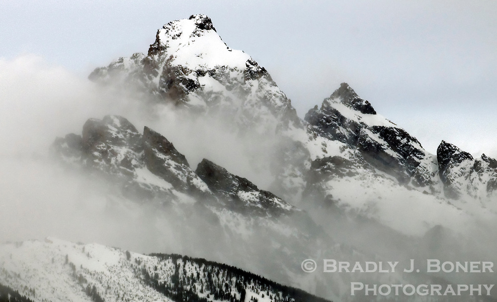 NEWS&GUIDE PHOTO / BRADLY J. BONER.Clouds clear from the summits of the Grand Teton and Mt. Owen on Saturday in Grand Teton National Park.