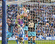 Sheffield Wednesday goalkeeper Keiren Westwood (1), punches clear under pressure from Brighton central defender, Lewis Dunk (5) during the Sky Bet Championship play-off second leg match between Brighton and Hove Albion and Sheffield Wednesday at the American Express Community Stadium, Brighton and Hove, England on 16 May 2016. Photo by David Charbit.
