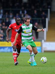 Tom Bolarinwa of Grimsby Town applies pressure on Matthew Dolan of Yeovil Town  - Mandatory by-line: Nizaam Jones/JMP - 29/10/2016/ - FOOTBALL - Hush Park - Yeovil, England - Yeovil Town v Grimsby Town - Sky Bet League Two