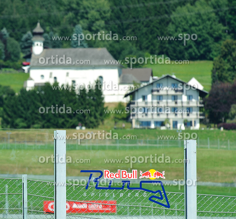 03.09.2011, Red Bull Ring, Spielberg, AUT, Ferrari Racing Days Spielberg, im Bild ein Featrure mit dem Red Bull Ring Logo, im Hintergrund der Enzinger Hof // during the Ferrari Racing Days on the Red Bull Circuit in Spielberg, 2011/09/03, EXPA Pictures © 2011, PhotoCredit: EXPA/ S. Zangrando